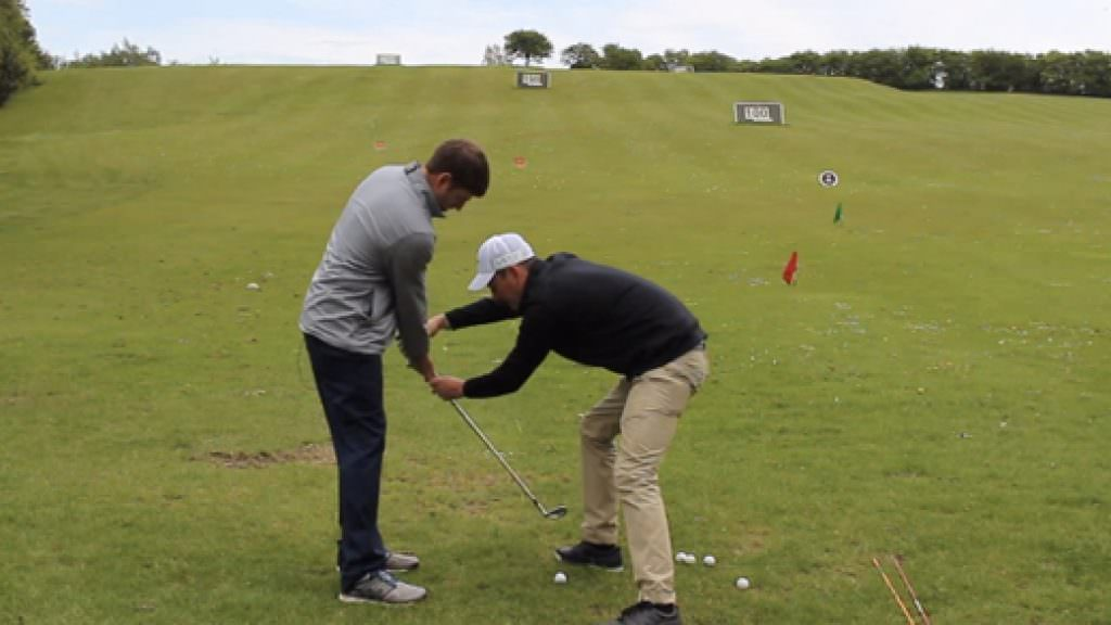 How to play a low wedge shot into the wind