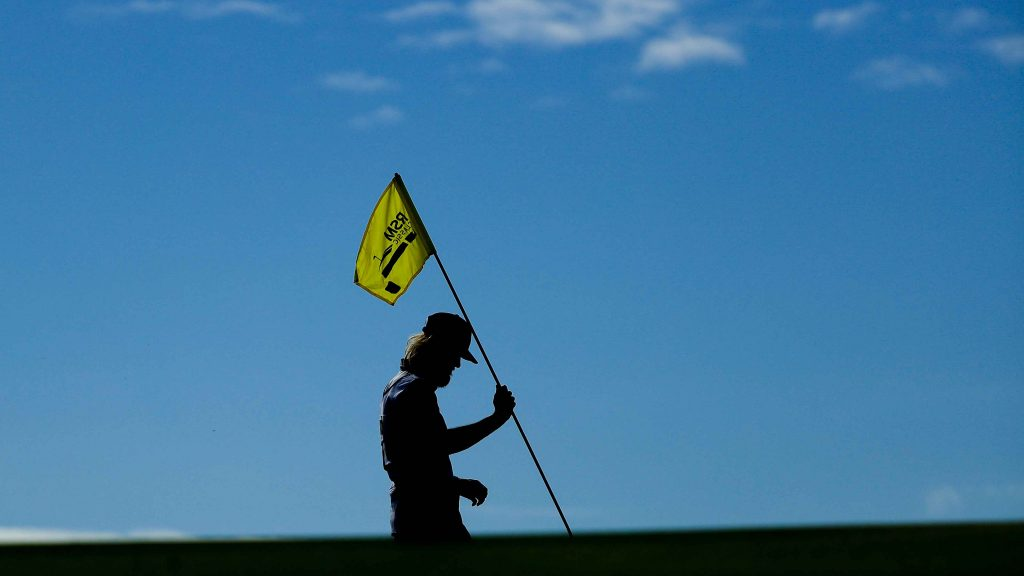 Why does something I've been doing on a golf course my entire life suddenly feel so surreal?